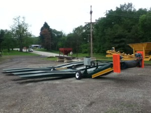 Double Drive Over Allows For Double Dumping, shown with ramps in towing position.